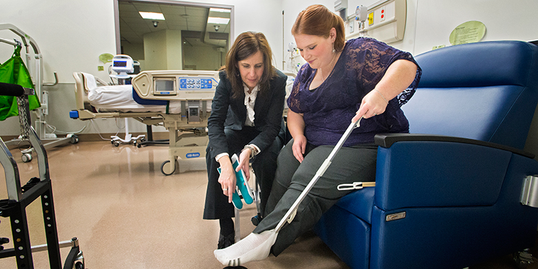 Bariatric researcher Mary Forhan (left), an assistant professor in the Department of Occupational Therapy, is working to improve the quality of life and care of patients such as Adrianna O'Regan, who underwent bariatric surgery in 2012. (Photo: Richard Siemens)