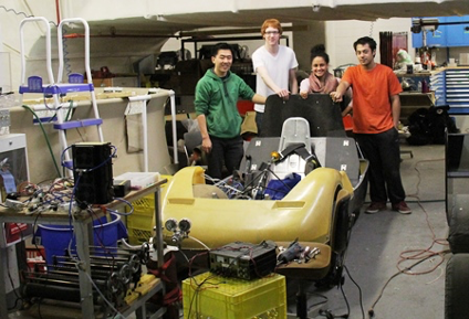 (From left) Eco Car team members Jason Wang, team leader Balazs Gyene, Salma Elmallah and Daniel Mosquera with the team's car during its building phase in March.