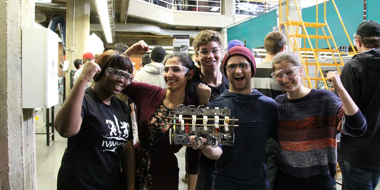 (From left) Mechanical engineering students Ebele Anekwe, Sarah Mattar, Brooks Atley, Ryan Musteca and Shealynn Carpenter strike a pose after putting their vehicle to the test in the robotic biathlon.