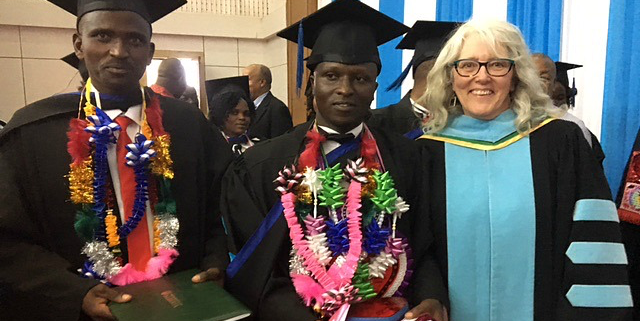 The first international graduates of the educational studies master's program had their own convocation ceremony Nov. 22 with education professor Elaine Simmt (right) and Faculty of Graduate Studies and Research dean Heather Zwicker (not pictured), who went to Tanzania to give them their parchments in person.