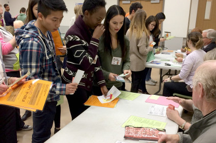Health science students take part in a poverty simulation