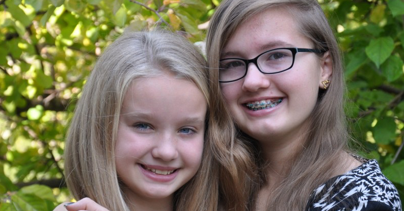 Jaiden (right) with her younger sister.