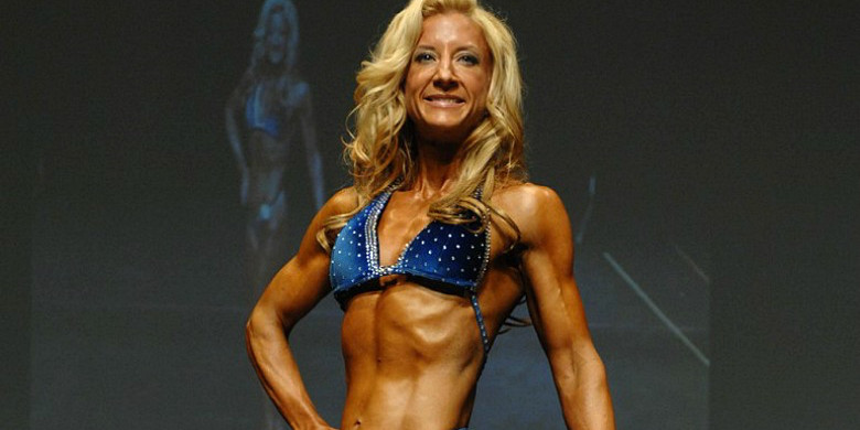 "Lianne McTavish in competition form in 2011. McTavish spent a year and a half training and competing as a ""figure girl"" as a personal challenge and a research project."