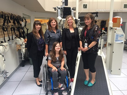 Maggie Slessor with (L-R) researcher Shanon Phelan,  mom Doreen, researcher Lesley Wiart and physical  therapist Kelsey Switzer.