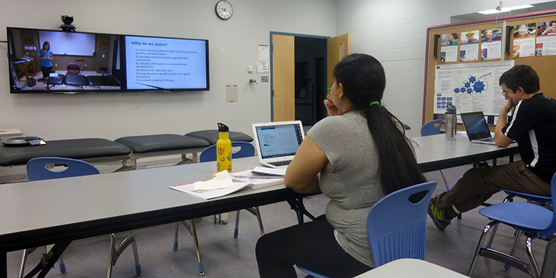Students participate in a lecture with their instructor and peers at the U of A's main campus in Edmonton via synchronous learning technology. The class was also connected to bridging program students in Calgary. (Photo courtesy Medicine Hat College)