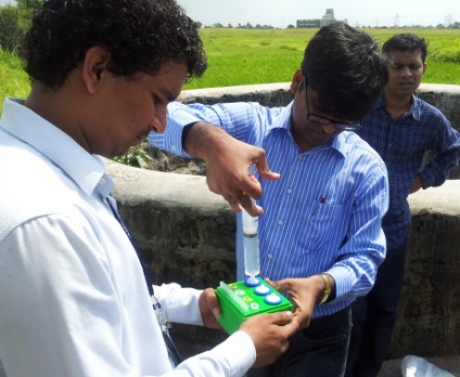 Naga Siva Gunda (centre), a post-doctoral fellow in Sushanta Mitra's research team, works with partners from Tata Consultancy Services and Primary Health Centre to deploy a mobile water kit for detecting E. coli in remote locations in India.