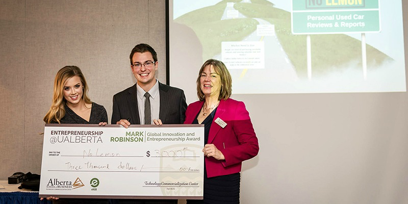 Ola Cislik (left) and her partner receive a cheque from Lesley Cormack, dean of the Faculty of Arts (right), at UAlberta's 10th annual Innovation and Entrepreneurship Dinner.