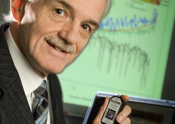 Philip Halloran holds a microarray, a tool used in the MMDx service, which he invented as a way to more accurately diagnose the reason why a transplanted organ is rejected. (Archived photo)
