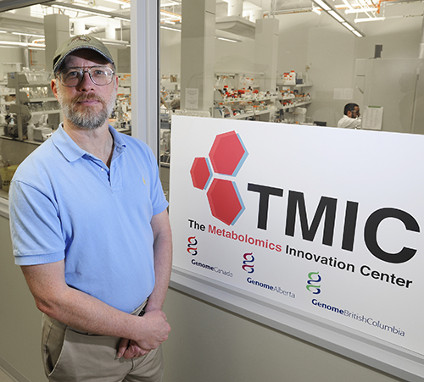 Professor David Wisharts stands in front of the Metabolomics Innovation Centre (TMIC)