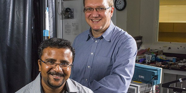 Professor Vakhtang Putkaradze (right), and Engineering PhD student Arindam Phani, in Phani's lab on September 8, 2016. The pair are working on a new paper about mechanical spectroscopy and sensing dangerous chemicals.Photo credit - John Ulan