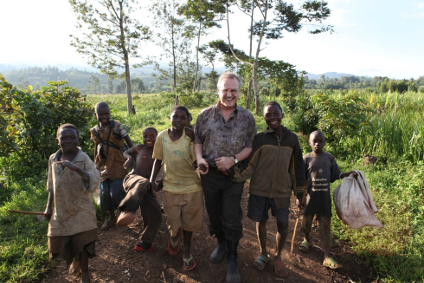 Stephen Lewis walks with children in the Democratic Republic of the Congo