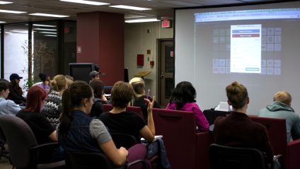 Students attend a red chair session at the Tech in Ed learning commons.