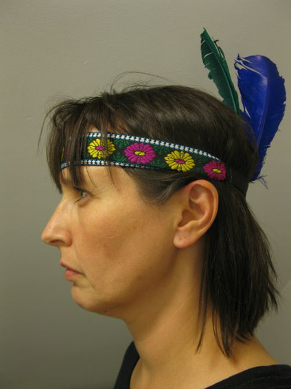 "Tanya Harnett took her self-portrait ""An Oxford Indian"" after a chance encounter with an Oxford partygoer wearing a feathered headband."