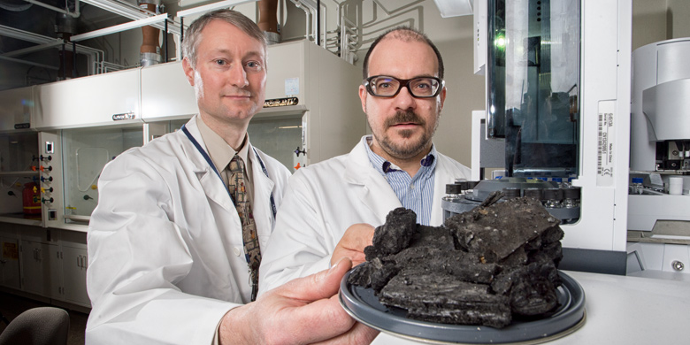 UAlberta researcher James Harynuk (right) and RCMP scientist Mark Sandercock are teaming up to develop a computer program that can sift through chemical clues left behind by arson.