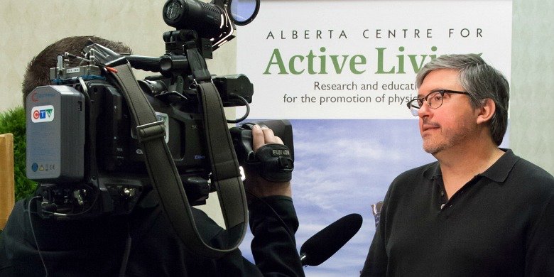 UAlberta researcher John C. Spence speaks with media during the 2014 Physical Activity Forum May 6. (Photo: Zoltan Kenwell)