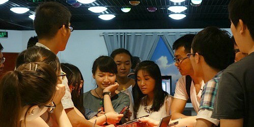 UAlberta students and Peking University students in the new Joint Summer Program on Innovation and Entrepreneurship learn about IT technologies at Lenovo in China. (Photo: Cen Huang)
