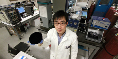 Xinwei Cui holds one of the nano-engineered carbon components of the new battery technology. (Photo: David Dodge)