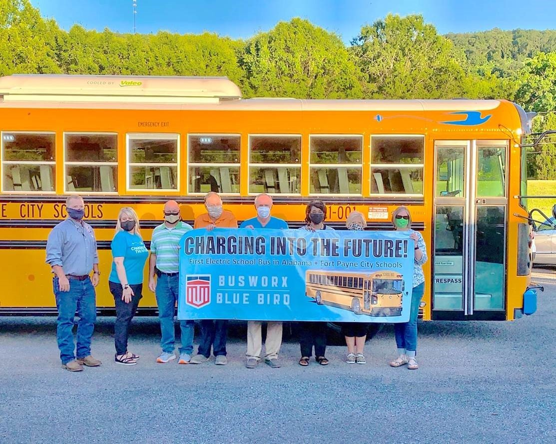 Fort Payne City Schools is the first district in the southeast United States to purchase 100% electric-powered school buses.  Pictured, from left, Busworx corporate bus sales manager Chris Bible, Transportation Director Laran Crowe-Adkins, school board member Neil Baine, board president Jimmy Durham, Superintendent Jim Cunningham, and board members Kathy Prater, Sharon Jones, and Carolyn Martin.  Photo courtesy of Steven Stiefel | Times-Journal