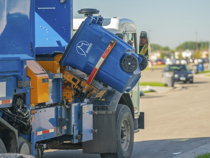 Moorhead Public Works crews pick up efficiency by picking up no-sort roller carts full of recyclables.