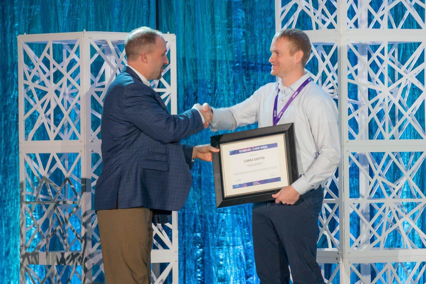 Lukas Gotto was named 2019 Technology Leader of the Year at the Impact Education Conference, December 16, 2019. Gotto is the Technology Integrationist at Alexandria Public Schools. Gotto (right) is pictured with Sourcewell CEO Chad Coauette.