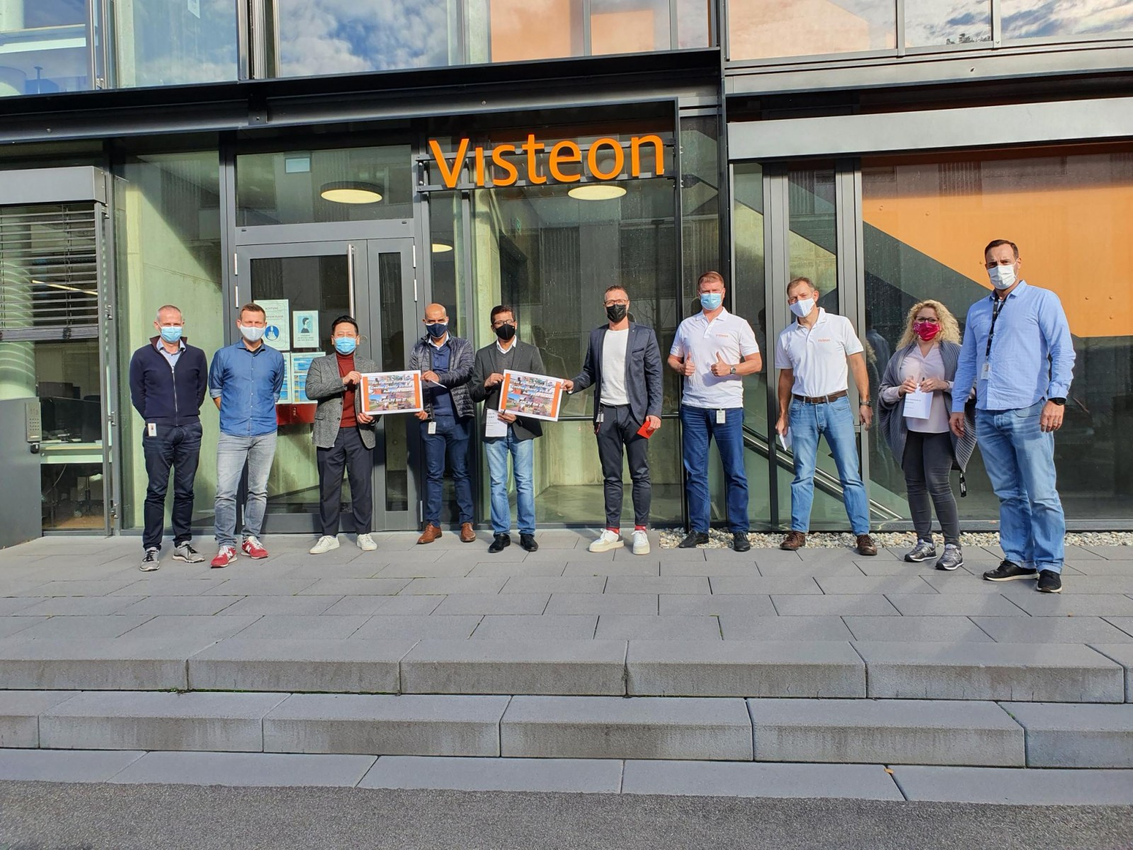 Employees at Visteon's technology center in Karlsruhe pose with the cheque for the children's charity