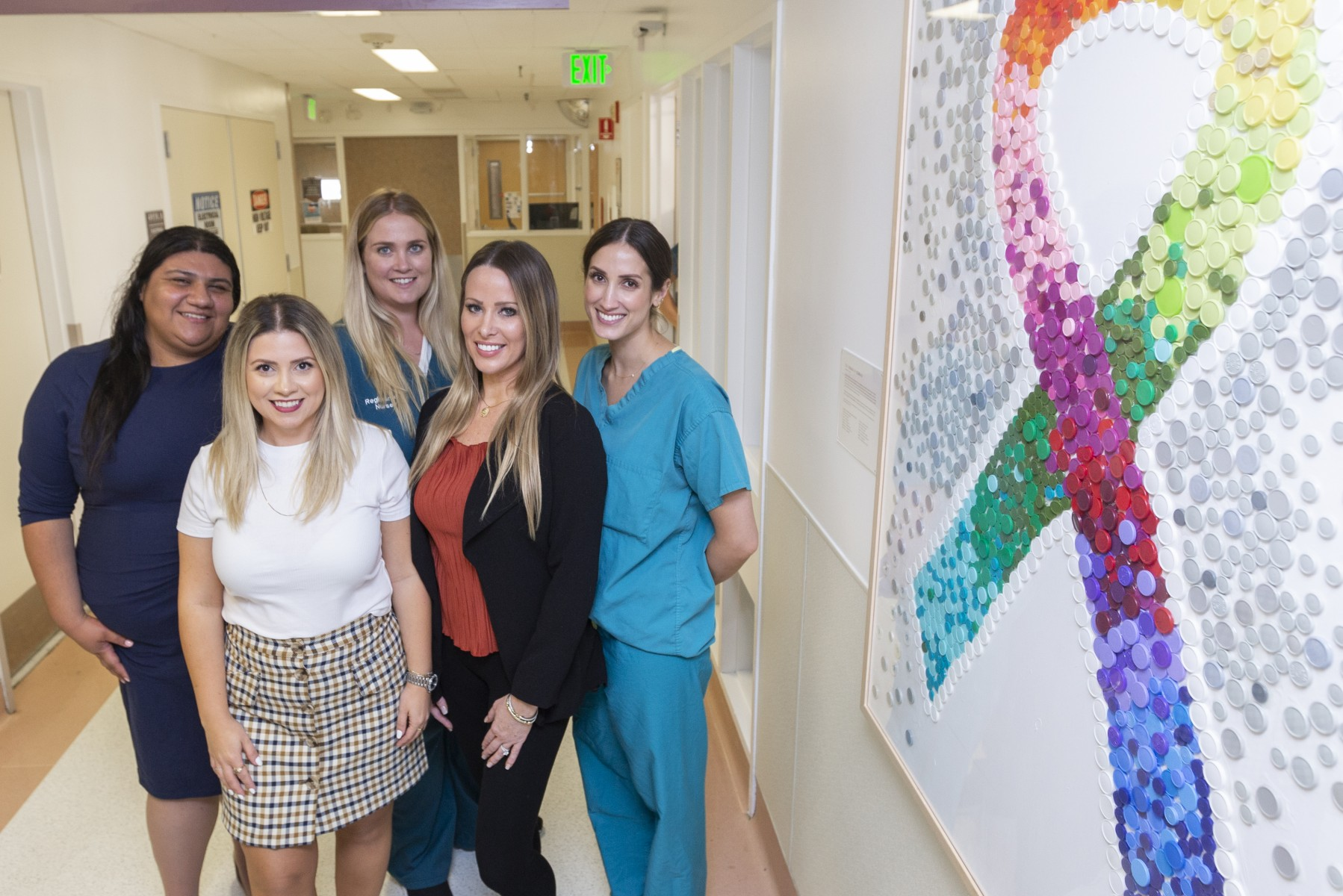 Oncology nurses Claudia Maldonado-Howell, MSN, FNP, CMSRN, Silva Amirkhanian, BSN, RN, CMSRN, Megan McCarthy, BSN, RN, Sarah Bishop, RN, OCN, and Sarah Schlachtman, RN, MSN, and their artwork. Photo by Cedars-Sinai.