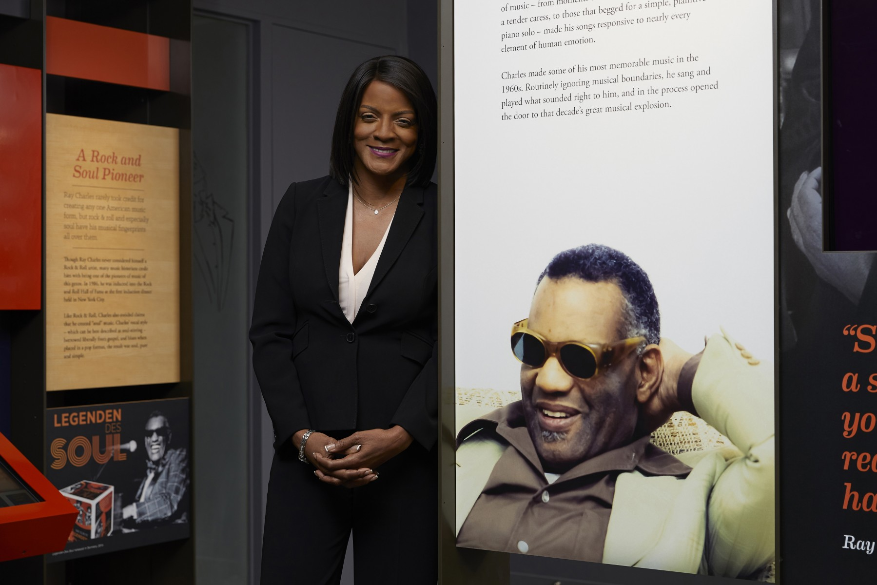 Ray Charles Foundation President Valerie Ervin with a photo of the music legend at the foundation headquarters in Los Angeles. Photo by Cedars-Sinai.