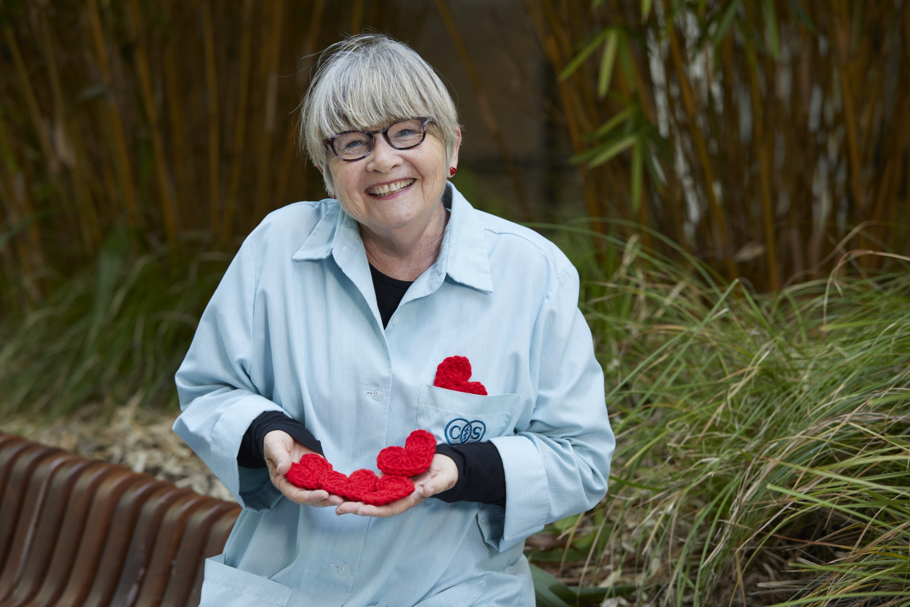 "Susan Nicholson is known as ""the heart lady"" around Cedars-Sinai because she crochets some 50 hearts every week for patients, staff members and visitors. Photo by Cedars-Sinai."
