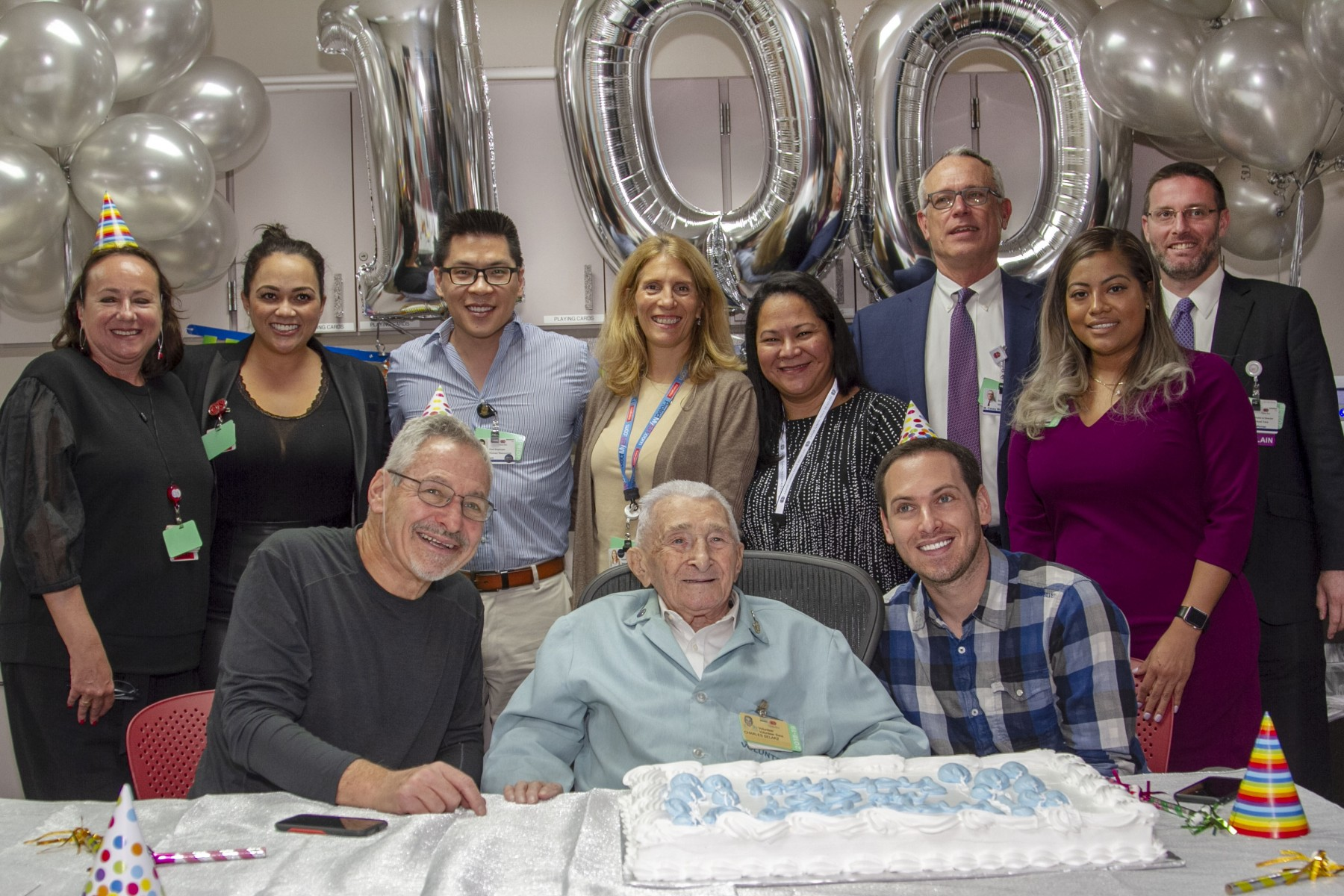 Volunteer Charles Selarz celebrates his 100th birthday with relatives and Cedars-Sinai staff members. Photo by Cedars-Sinai.