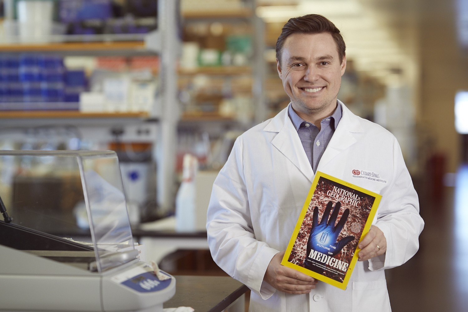 Samuel Sances, PhD, with the National Geographic issue that profiled the work of the Board of Governors Regenerative Medicine Institute. Photo by Cedars-Sinai.