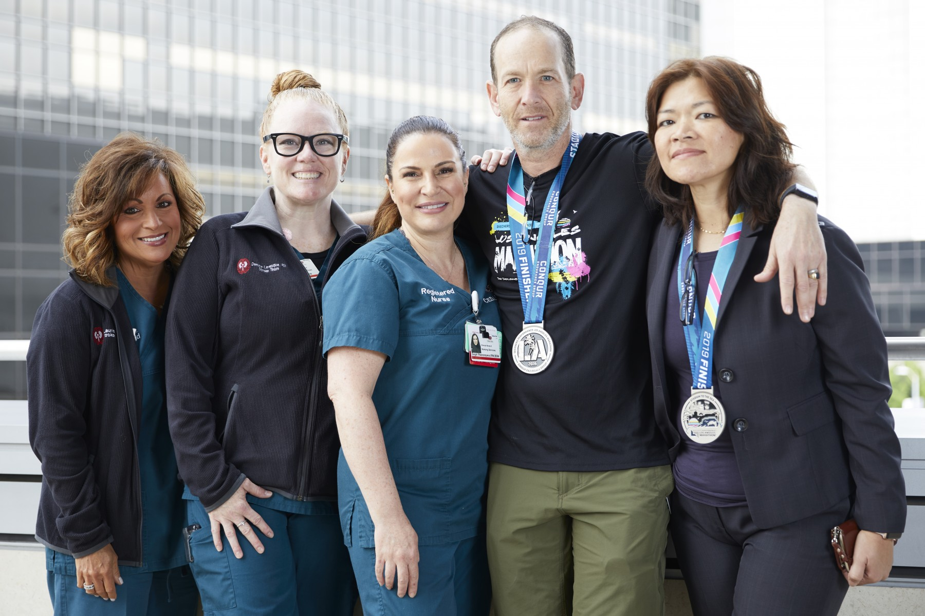 Stroke patient Gregory Rutchik with members of his care team. From left to right, Laurie Paletz, RN; Denise Levesque, RN; Sogol Rezvanpour, RN; Rutchik and Marianne Carlota, RN. Photo by Cedars-Sinai.