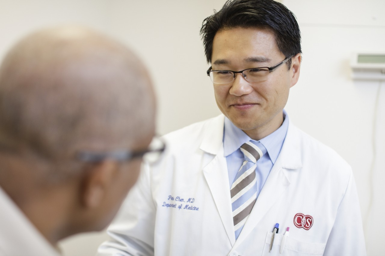 In this photo taken before COVID-19, Peter Chen, MD, explains a diagnosis to a patient. Photo by Cedars-Sinai.