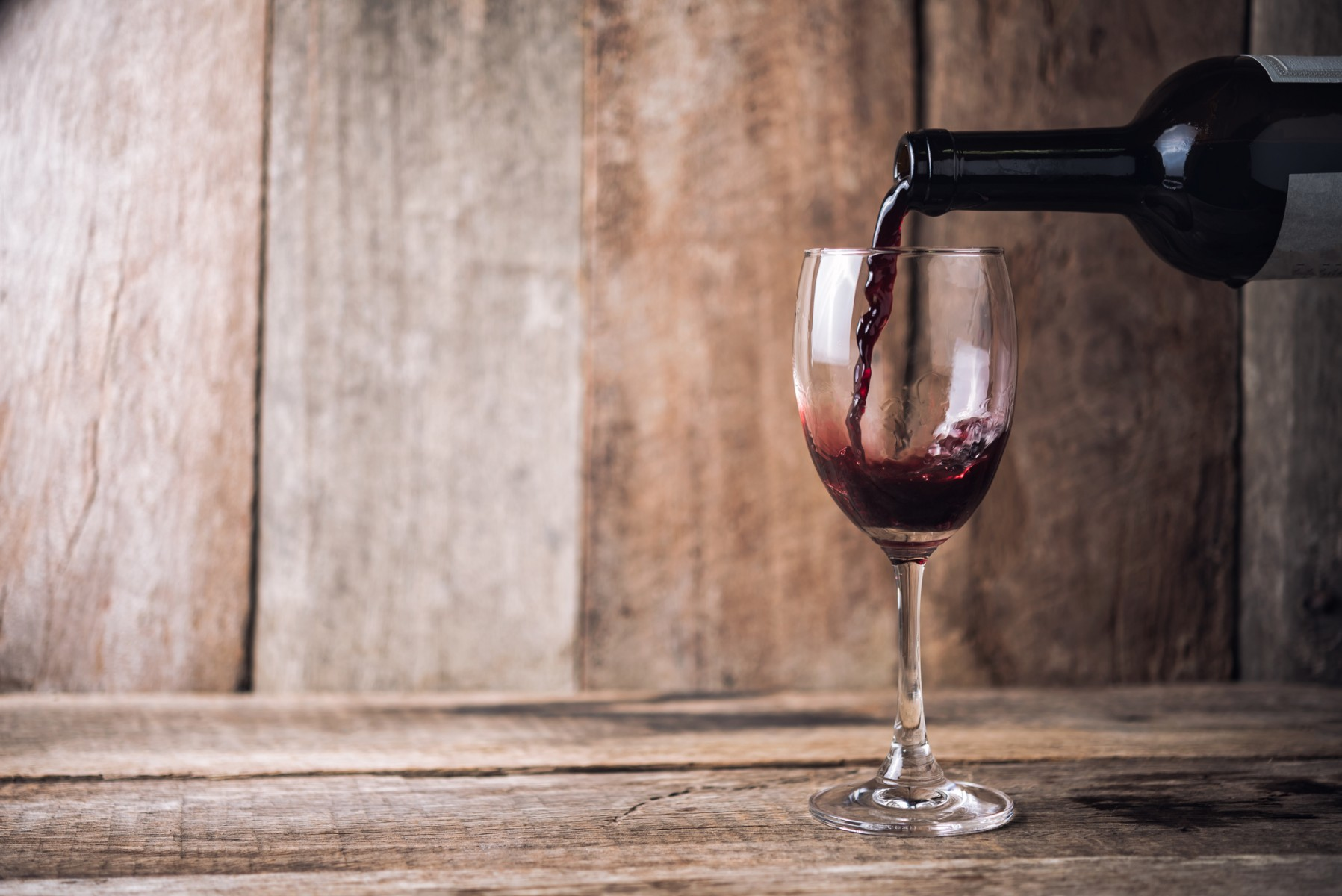 Drinking red wine in moderation may reduce one of the risk factors for breast cancer, a study shows. Photo by Getty.