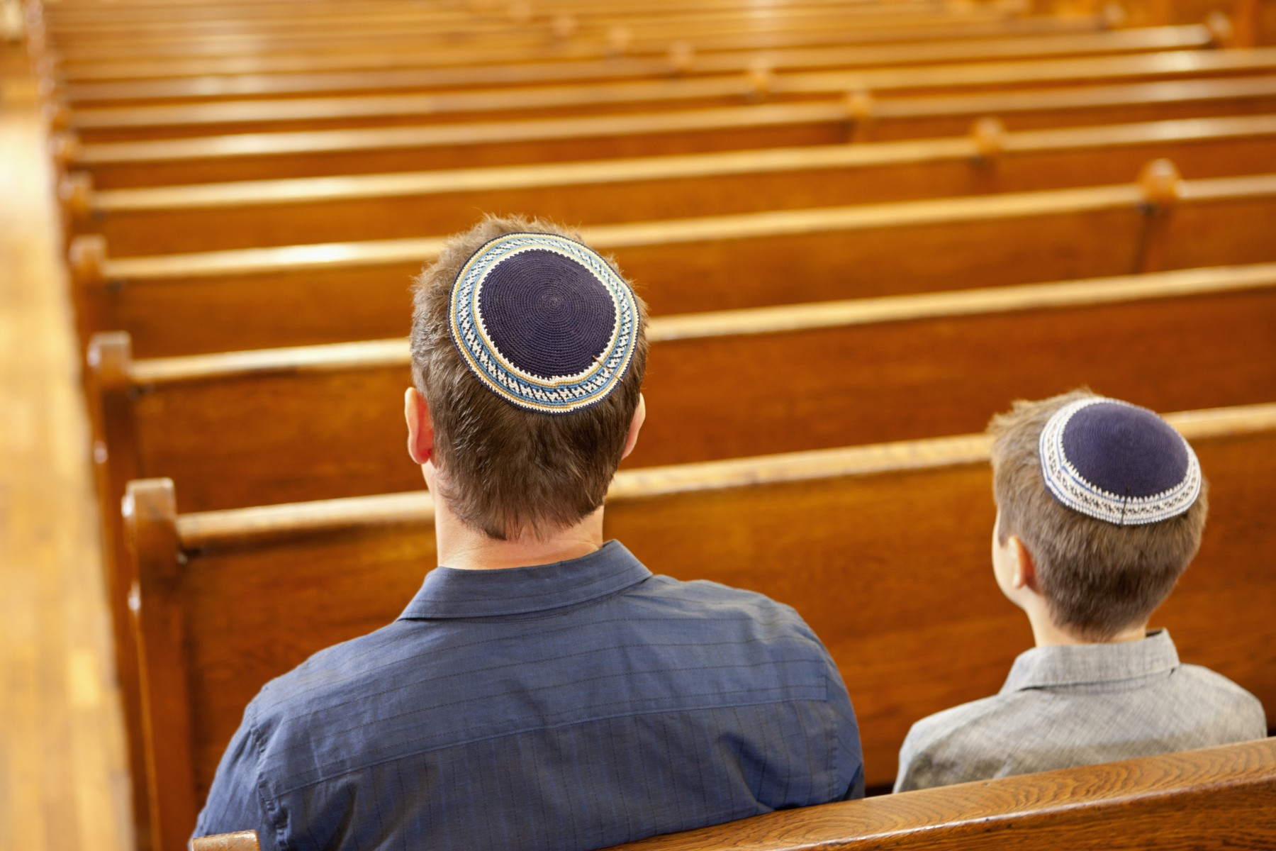 A Jewish father and son pray. Photo by Getty Images.