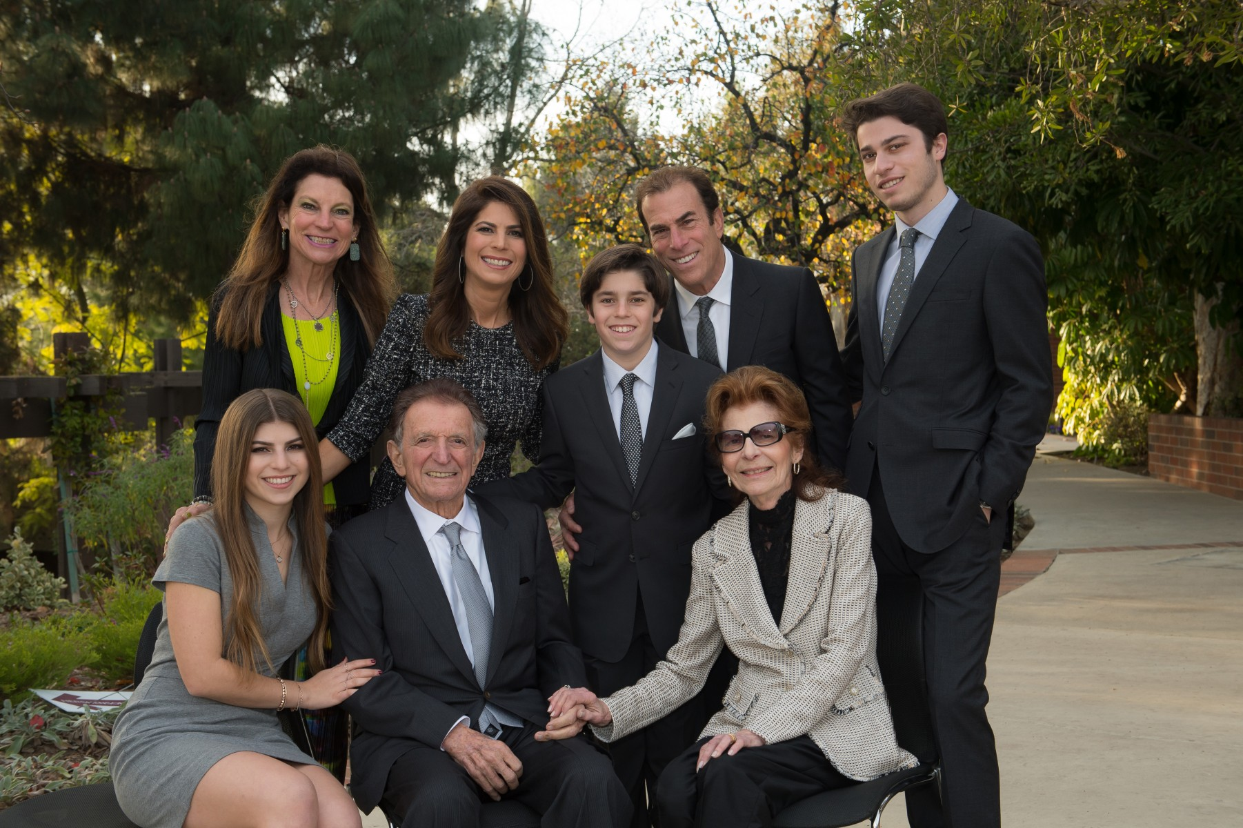 Melinda Goldrich (standing, far left) and Andrea Goldrich Cayton (standing, second from left) have donated $10 million in honor of their late father, Jona Goldrich (seated, center), to establish the Jona Goldrich Center for Alzheimer's and Memory Disorders. Photo courtesy of the Goldrich family.