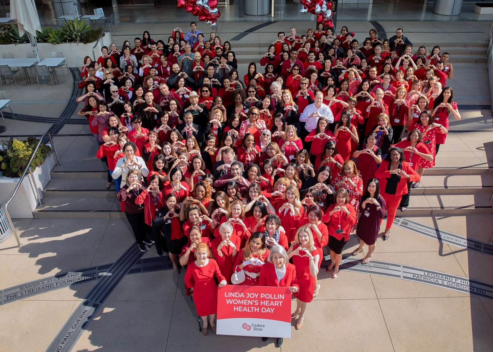Cedars-Sinai health professionals dressed in red to show support for heart disease, the No 1. killer of women. Photo by Cedars-Sinai