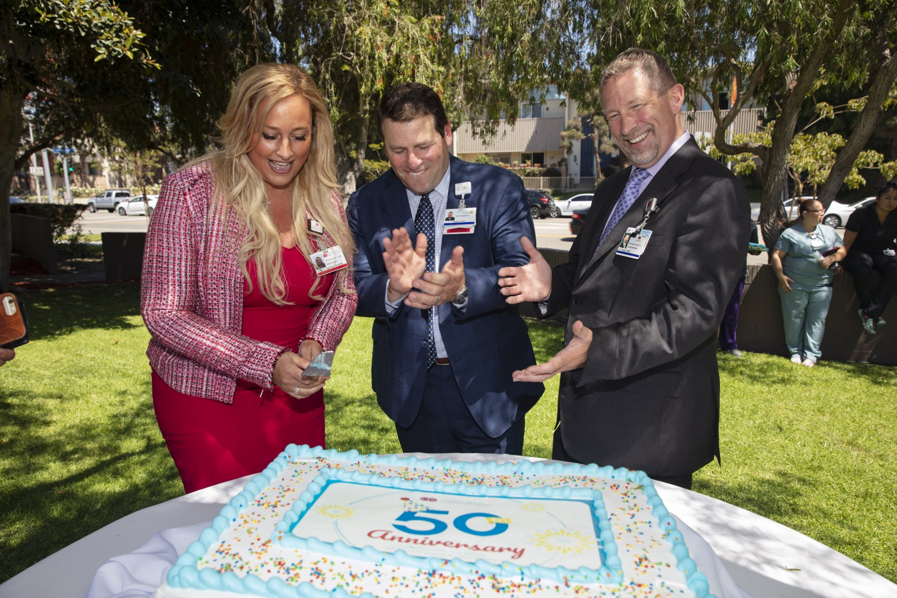 From left: Joanne Laguna-Kennedy, MSN, RN, VP of Hospital Operations and Chief Nursing Officer at Cedars-Sinai Marina del Rey Hospital, cuts the cake at the hospital's 50th anniversary party joined by Bryan Croft, Senior Vice President of operations,  and Jeff Smith, MD, JD, MMM, CEO of Cedars-Sinai Marina del Rey Hospital. Photo by Cedars-Sinai.
