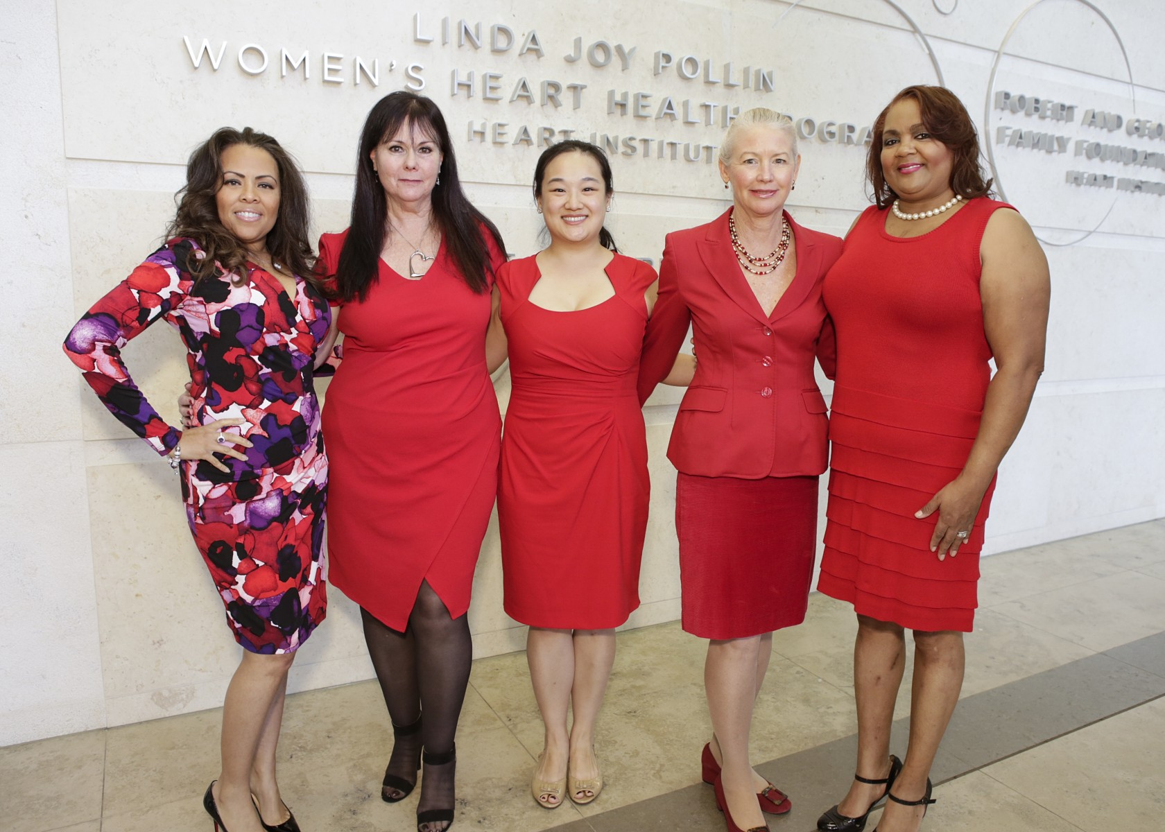 Barbara Fleeman, second from left, and Noel Bairey Merz, MD, second from right, attend an event at the Barbra Streisand Women's Heart Center in the Smidt Heart Institute. Photo by Cedars-Sinai.