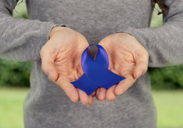 A blue ribbon symbolizes support for colon cancer.  Photo by Getty.