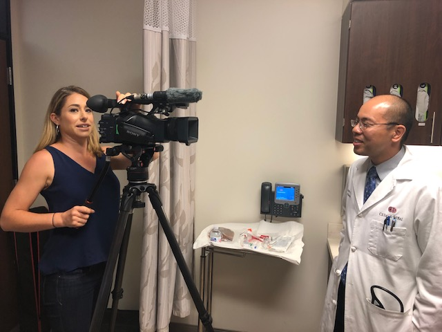 Spectrum News 1 reporter Sarah Pilla interviews and Edmund Huang, MD, at Cedars-Sinai's Comprehensive Transplant Center. Photo by Cedars-Sinai.