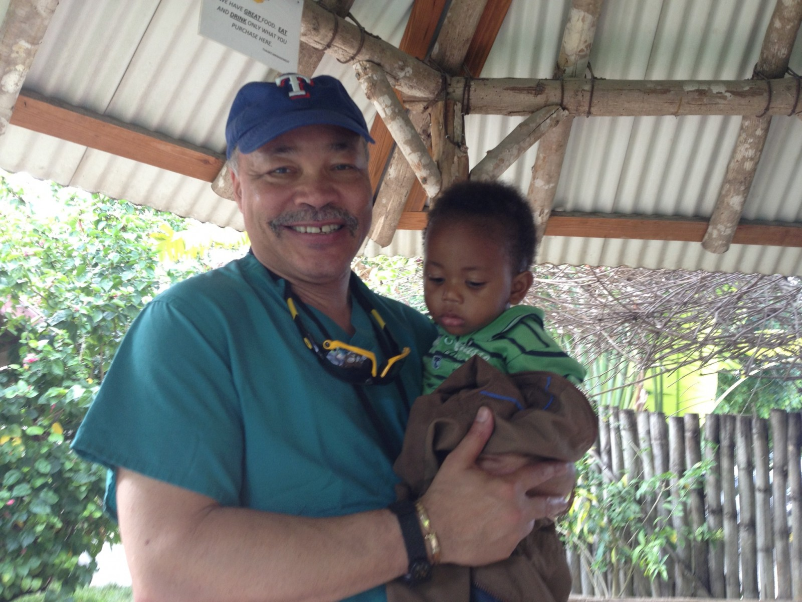 Dr. Stoute with a Patient in Jamaica