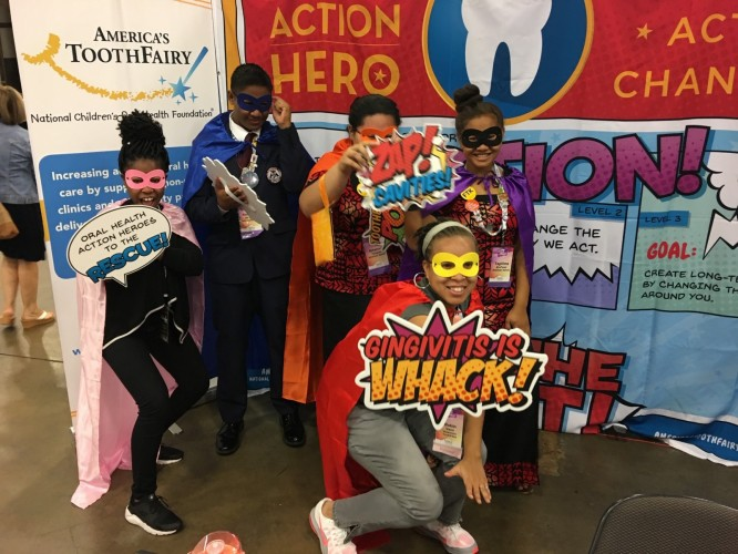 Vann educates students at the HOSA conference, encouraging all kids to be heroes in their communities when it comes to oral health.