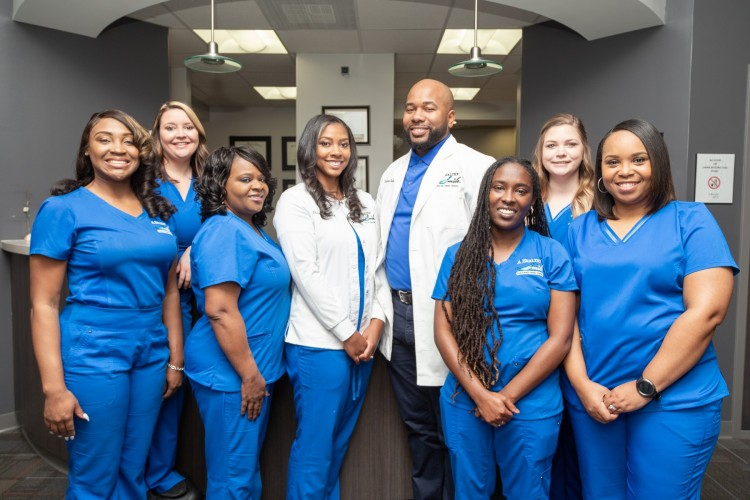 Dr. Loray and Dr. Harvey Spencer with the Healthy Smile team.