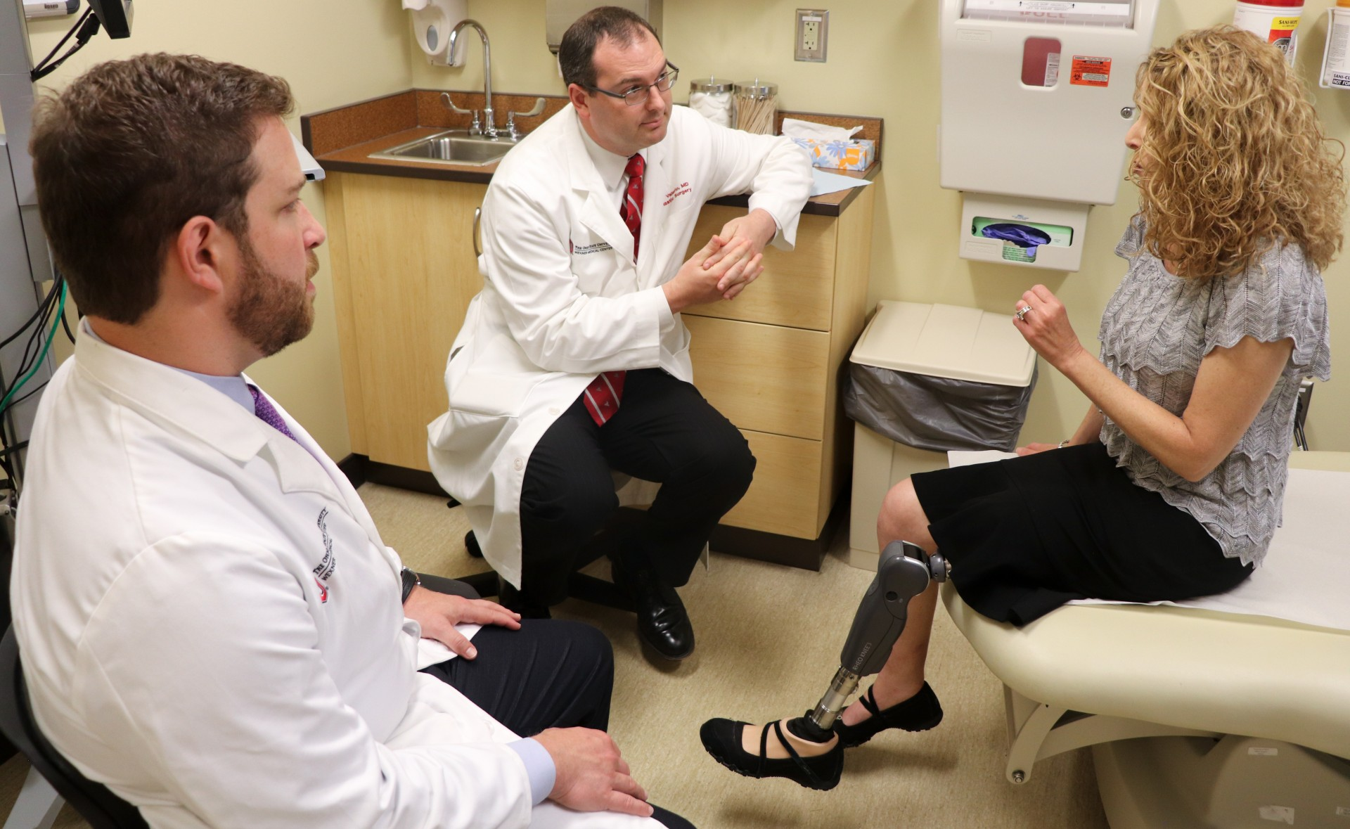 Dr. J. Byers Bowen (left) and Dr. Ian Valerio follow up with a leg amputee who had targeted muscle reinnervation surgery at Wexner Medical Center.