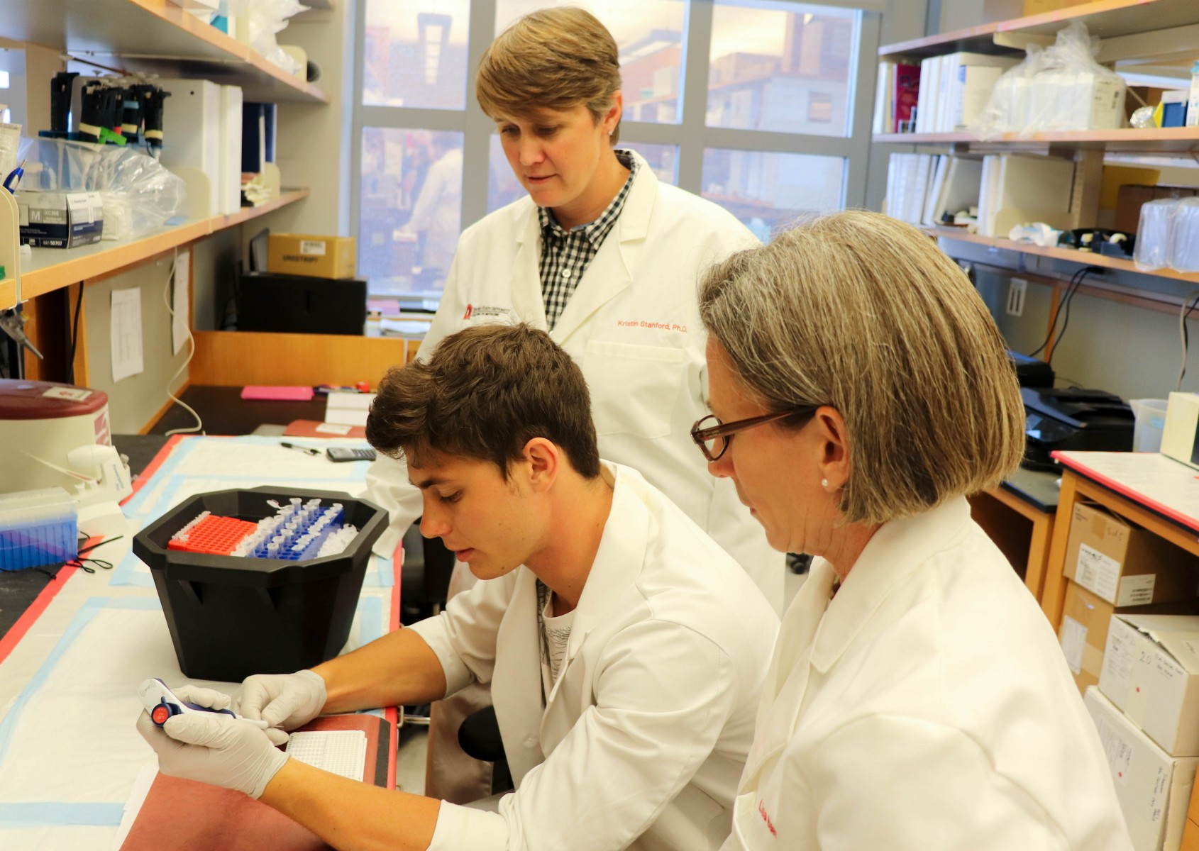 Researchers examine the small-RNA of mice in a lab at The Ohio State University Wexner Medical Center.
