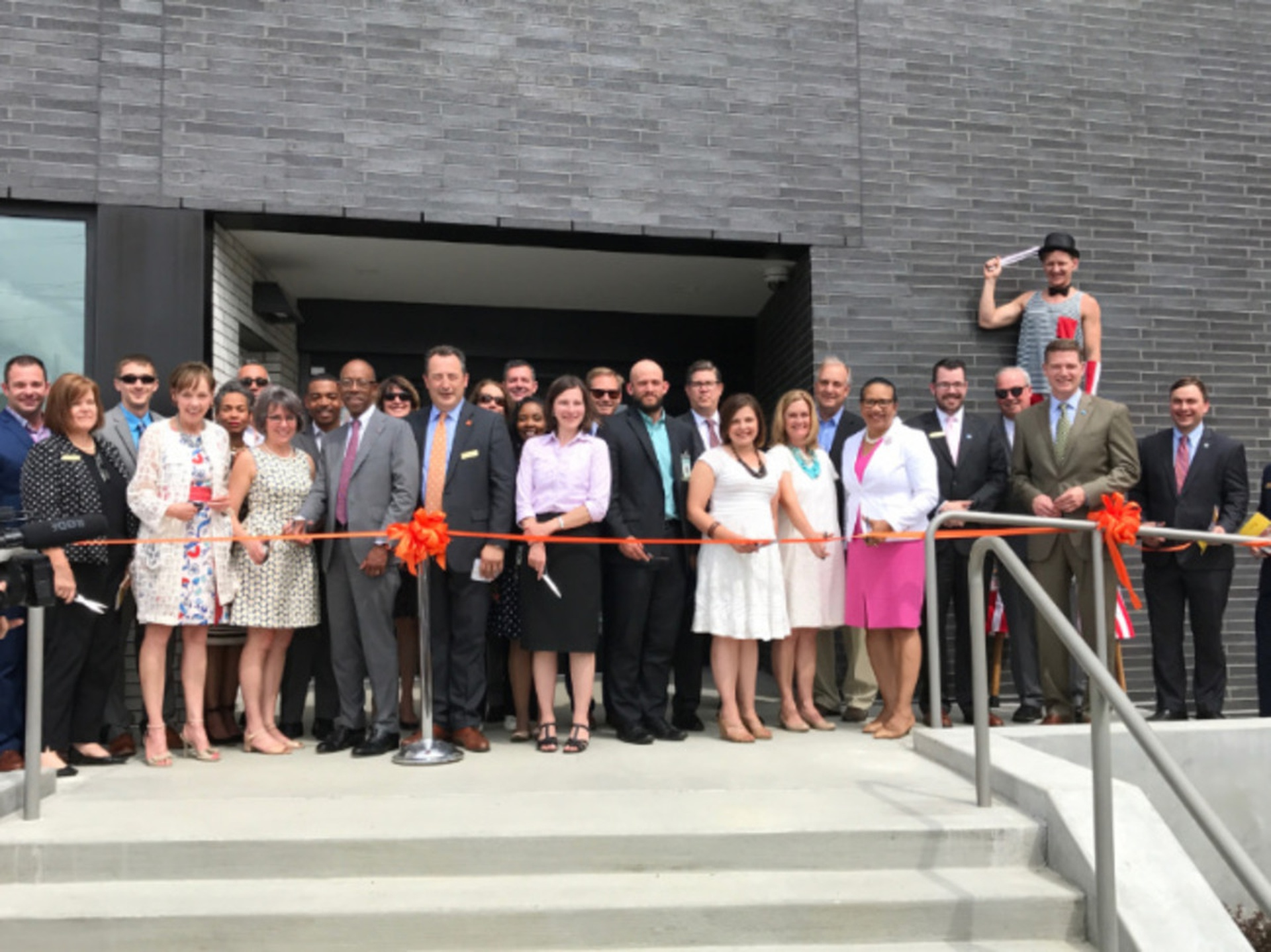 President Drake joins library supporters for a ribbon cutting of the new Northside Branch