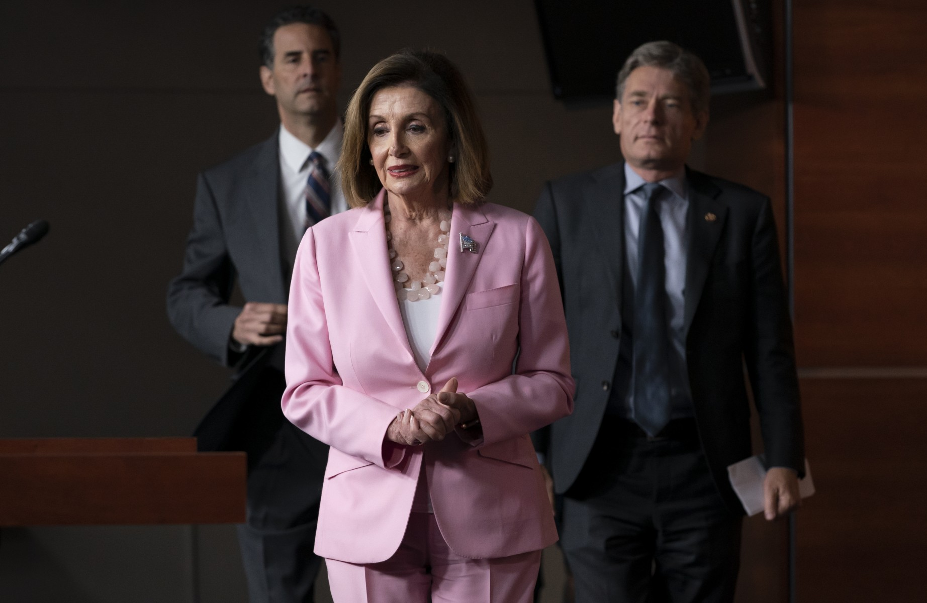 Speaker of the House Nancy Pelosi, D-Calif., joined by Rep. John Sarbanes, D-Md., left, and  Rep. Tom Malinowski, D-N.J., leads House Democrats to discuss H.R. 1, The For the People Act, which passed in the House but is being held up in the Senate, at the Capitol in Washington, Friday, Sept. 27, 2019.   (AP Photo/J. Scott Applewhite)