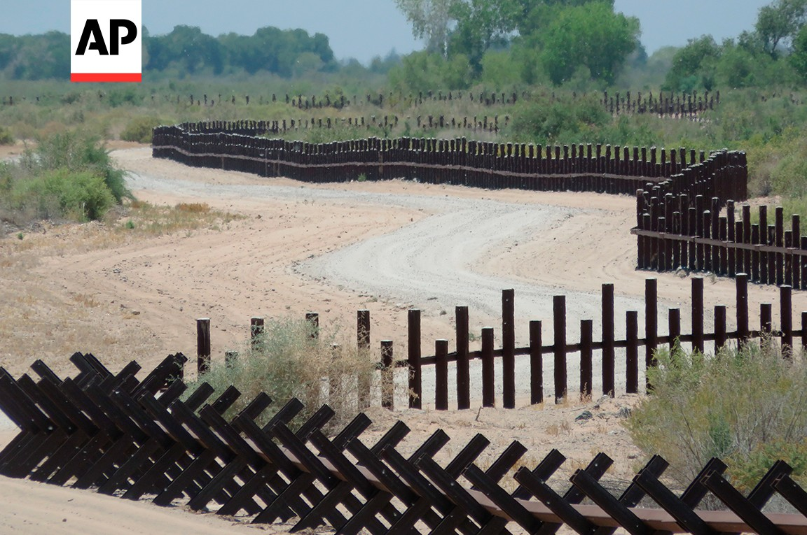 "This June 15, 2017, photo provided by Kenneth Madsen, shows a post-on-rail style of fence along the flood plain of the Colorado River between Arizona and Baja California, which is typical of border wall fences placed in environmentally sensitive areas or in areas prone to flooding. A new photo exhibit by Madsen opening Wednesday, Sept. 19, 2018, at the Ohio State University-Newark campus, ""Up Close with U.S.-Mexico Border Barriers,"" highlights different types of border wall fencing. (Kenneth Madsen via AP)"