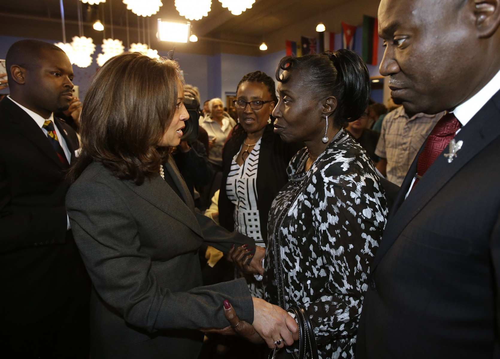 U.S. Sen. Kamala Harris, D-Calif., left, talks with constituent at town hall.  (AP Photo/Rich Pedroncelli)