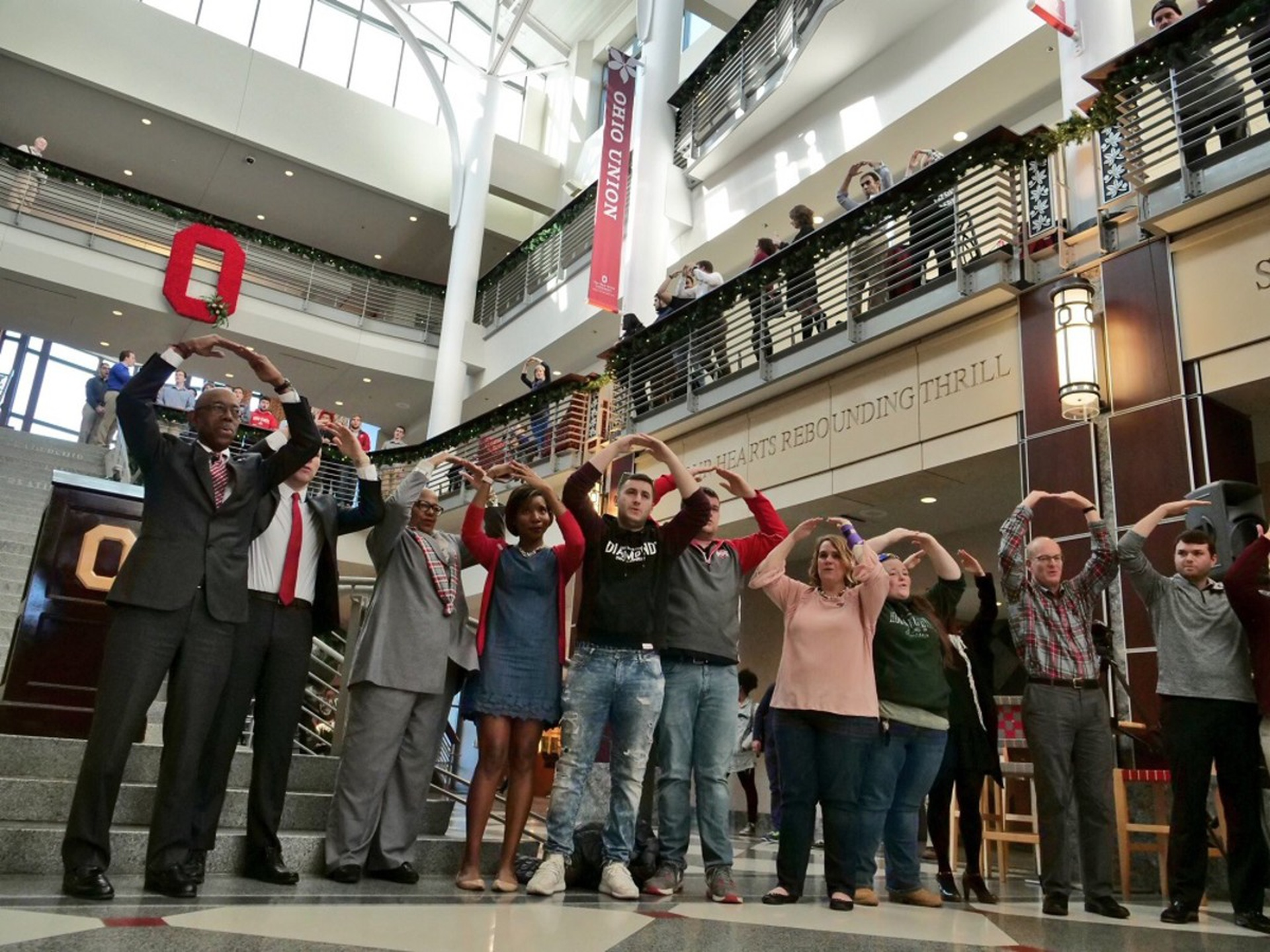 President Drake leads students, faculty and staff in Carmen Ohio. Photo by Gail Martineau